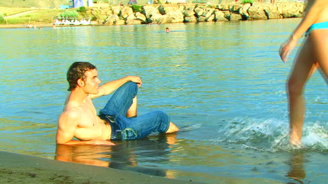 Young Man Relaxing on the Beach video