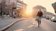SLO MO Young man riding a bicycle in the city video