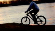 Young man riding bicycle video