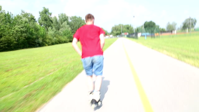 Young man rollerblading in park on a beautiful day video
