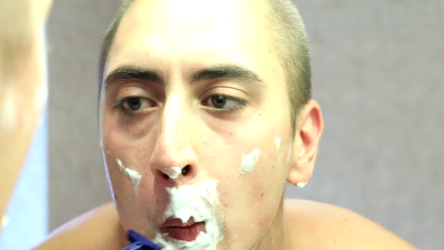 Young man shaving video