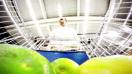 Young man shopping for fruit in the supermarket video