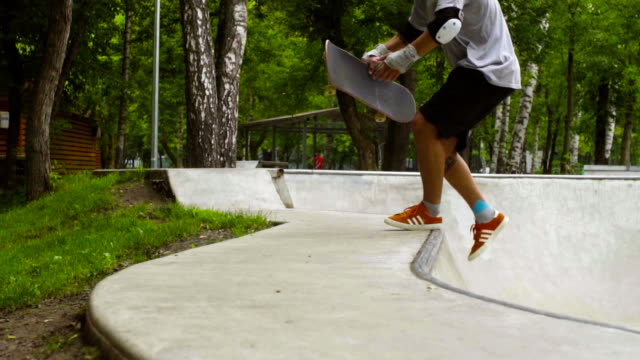 Young man skateboarding at outdoor skate park video