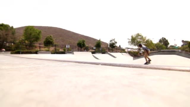 Young Man Skateboarding In Skatepark video