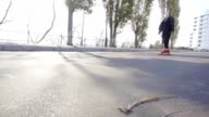 young man skates on his longboard on the road in the city video