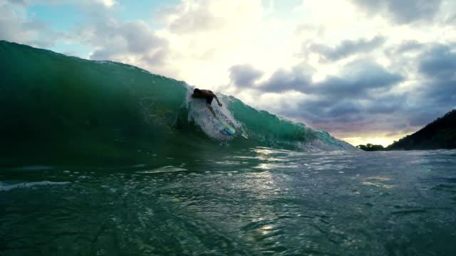 Young Man Surfing in Ocean video