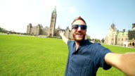 Young man taking selfie at parliament Hill Ottawa video