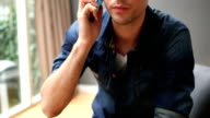 CU TU Young man talking on phone and smiling video