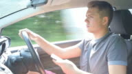 Young Man Texting On Mobile Phone Whilst Driving Car video