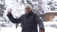 SLOW MOTION: Young man throwing a snowball video
