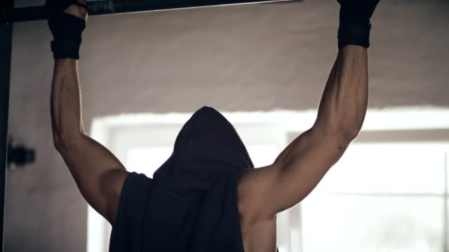 Young man training on chin-up bar video