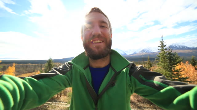 Young man traveling in Canada takes selfie portrait video
