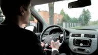Young man using mobile phone in the car video