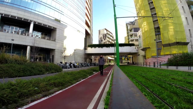 Young man walking near tramway video