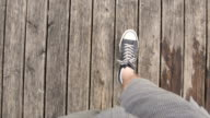 Young man walking on the wooden boards video