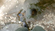 Young man walking on water in tropical jungle forest video