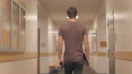 Young Man Walks College Halls video