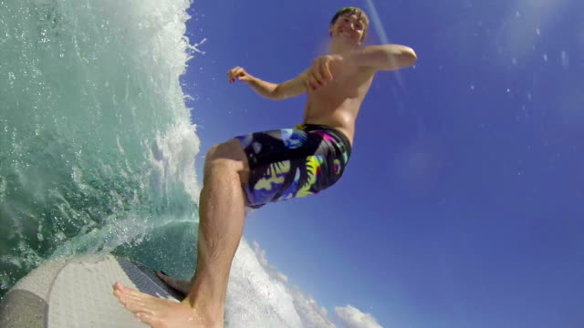 Young man wave surfing video