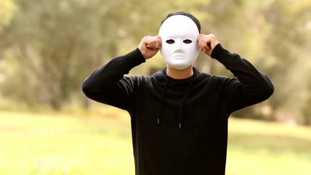 young man with mask faking emotion video