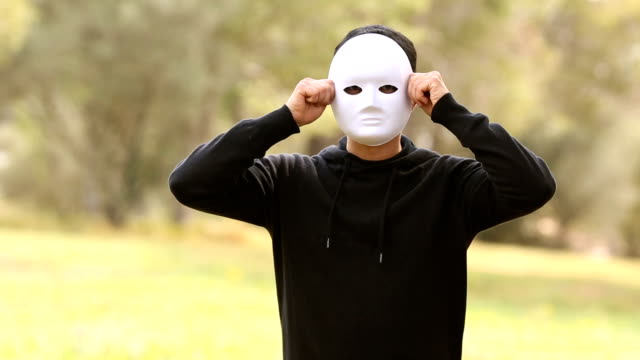 young man with mask representing aggressive emotions video