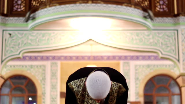 young man worship in a mosque. video