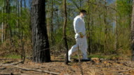 Young manin special suit walking in the wood video