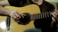Young man's hands playing the acoustic guitar. video
