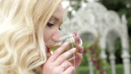 A young married woman drinking tea. video