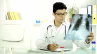 Young Medical Doctor Examining Xray Prescribing Pills video