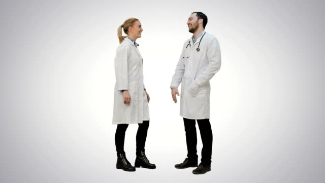 Young medical students give each other five after exam on white background video