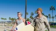 Young men going surf at Venice beach video