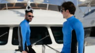 Young men on yacht. video