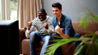 MS Young men watching television and giving high-five video