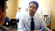 Young mixed race businessman interviews potential employee video