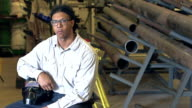 Young mixed race man in factory with welding mask video
