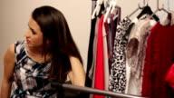 young model choosing dress to wear VIDEO video