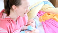 Young mother cradling baby in her arms video