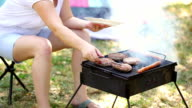 Young Mother Grilling Meat On Barbecue video