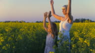 HD DOLLY: Young Mother Practising Yoga With Her Daughter video