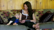 Young mother reads to child video