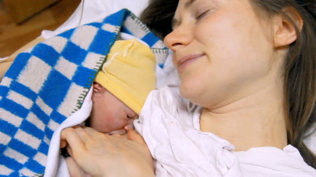 Young mother with newborn baby video