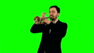 Young musician playing trumpet on a Green Screen video