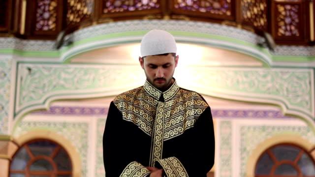 young muslim man worship inside mosque video
