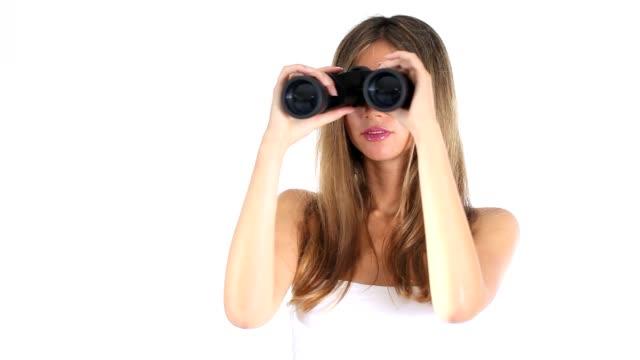 young nice woman looking through binoculars video