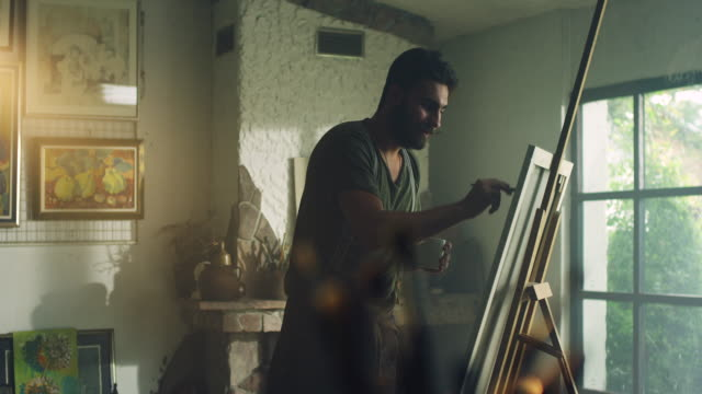 Young painter working video