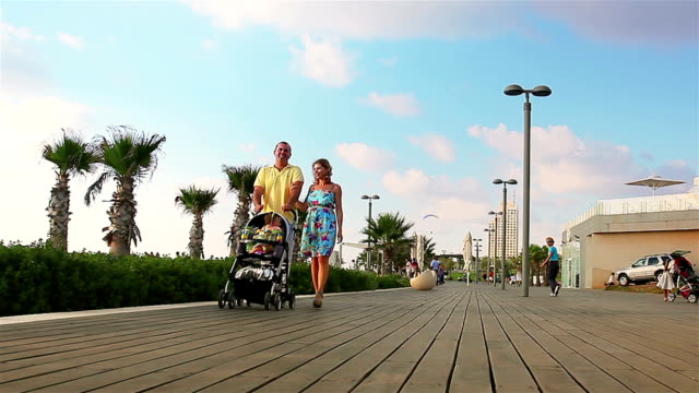 Young parents walking together with their baby video