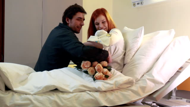 Young parents with newborn baby video