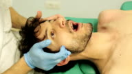 young patient is visited by a physiotherapist: mouth opening, chewing, pain video
