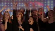 Young peoole celebrate on dancefloor video
