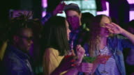 Young people enjoying dancing at party video